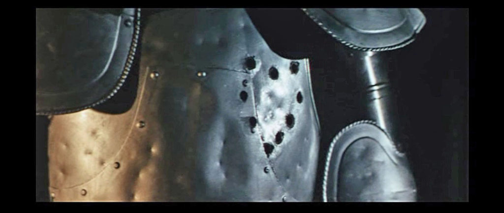 "From the movie ""A Fistful of Dollar"" - The scene which punctures a heart mark with a gun on armor."