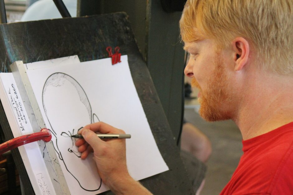 man drawing caricature